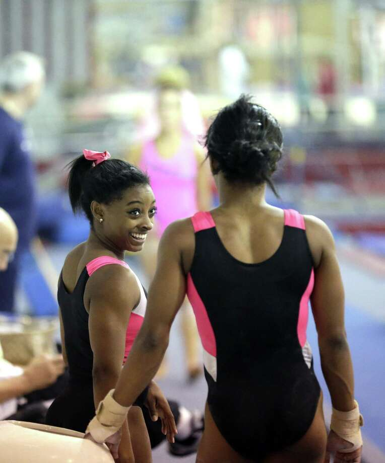 U.S. gymnast Simone Biles (left) smiles as she talks with Gabby Douglas during a September 2015 training session at the Karolyi Ranch in New Waverly. Four-time 2016 gold medalist Biles is one of the gymnasts who have said they were abused by Nassar under the guise of medical treatment. Photo: Associated Press File Photo / AP