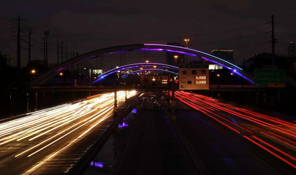 Lights are turned back on bridges over the Southwest Freeway in Montrose at sunset on Saturday, Jan. 27, 2018, in Houston. The lights were turned off on January 19 because the Montrose Management District could not pay the utility bill while under a temporary court order. ( Yi-Chin Lee / Houston Chronicle )