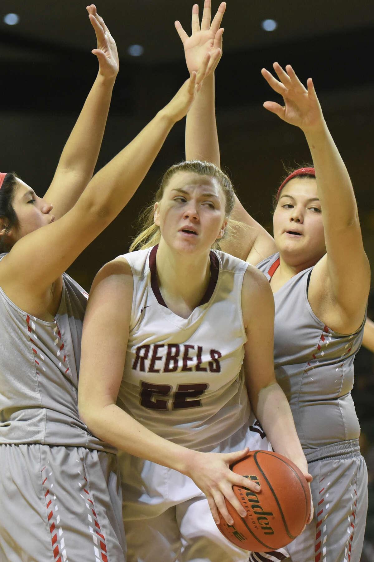 Lee's Elizabeth McRae (22) comes down with a rebound against Odessa High on Jan. 30, 2018, at Chaparral Center. James Durbin/Reporter-Telegram