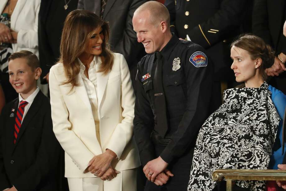 First lady Melania Trump talks with Albuquerque Police Officer Ryan Holets and this wife before the State of the Union address to a joint session of Congress on Capitol Hill in Washington, Tuesday, Jan. 30, 2018. (AP Photo/Pablo Martinez Monsivais) Photo: Pablo Martinez Monsivais/AP