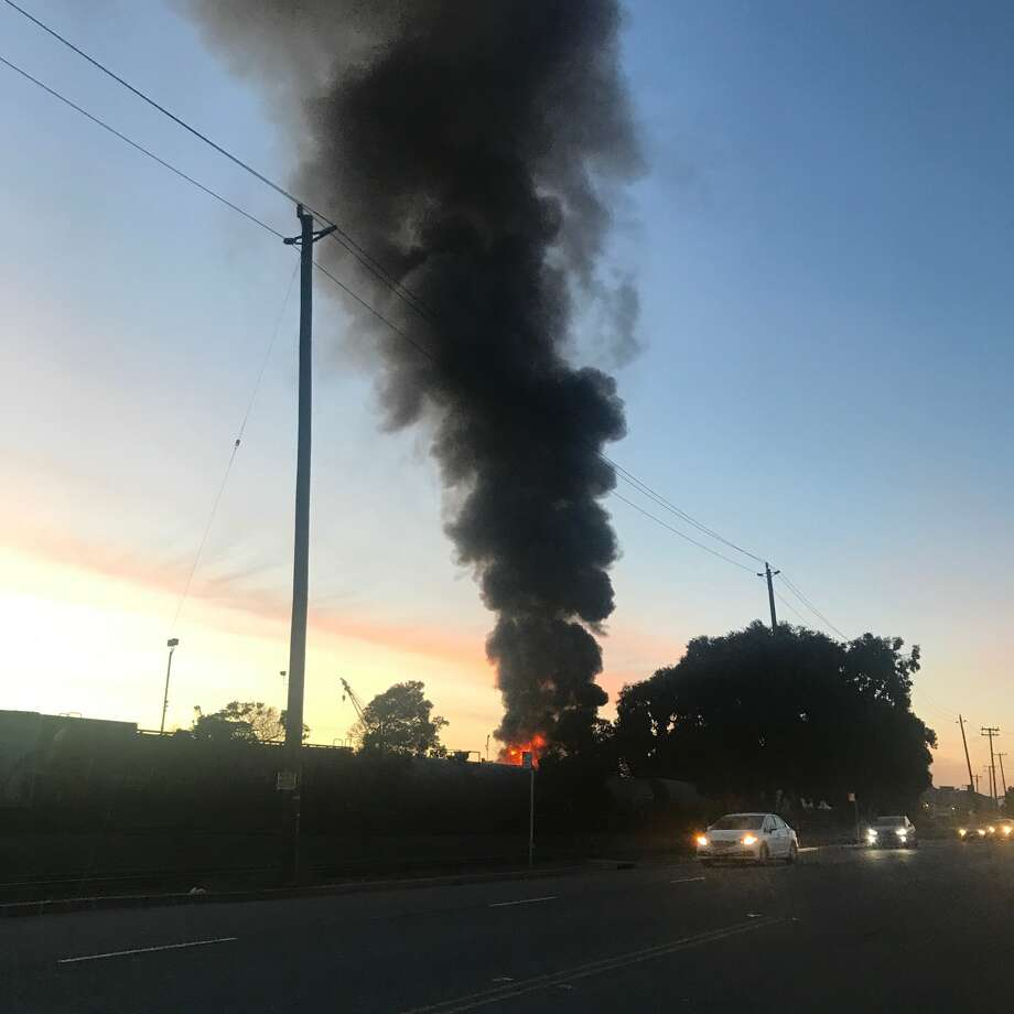 Smoke and flames from a fire at a Richmond scrap metal yard is seen Tuesday evening. Photo: Courtesy Supervisor John Gioia