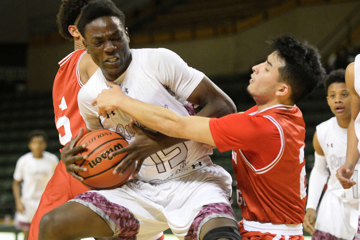 Lee's Pat Okimi (15) collides with Odessa High's Isaac Hernandez (2) on Jan. 30, 2018, at Chaparral Center. James Durbin/Reporter-Telegram