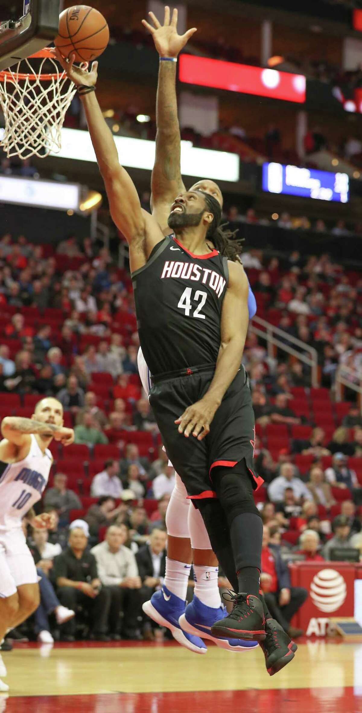Orlando Magic forward Marreese Speights (5) could stop Houston Rockets center Nene Hilario (42) from scoring in the 1st-quarter of an NBA basketball game at Toyota Center on Tuesday, Jan. 30, 2018, in Houston.
