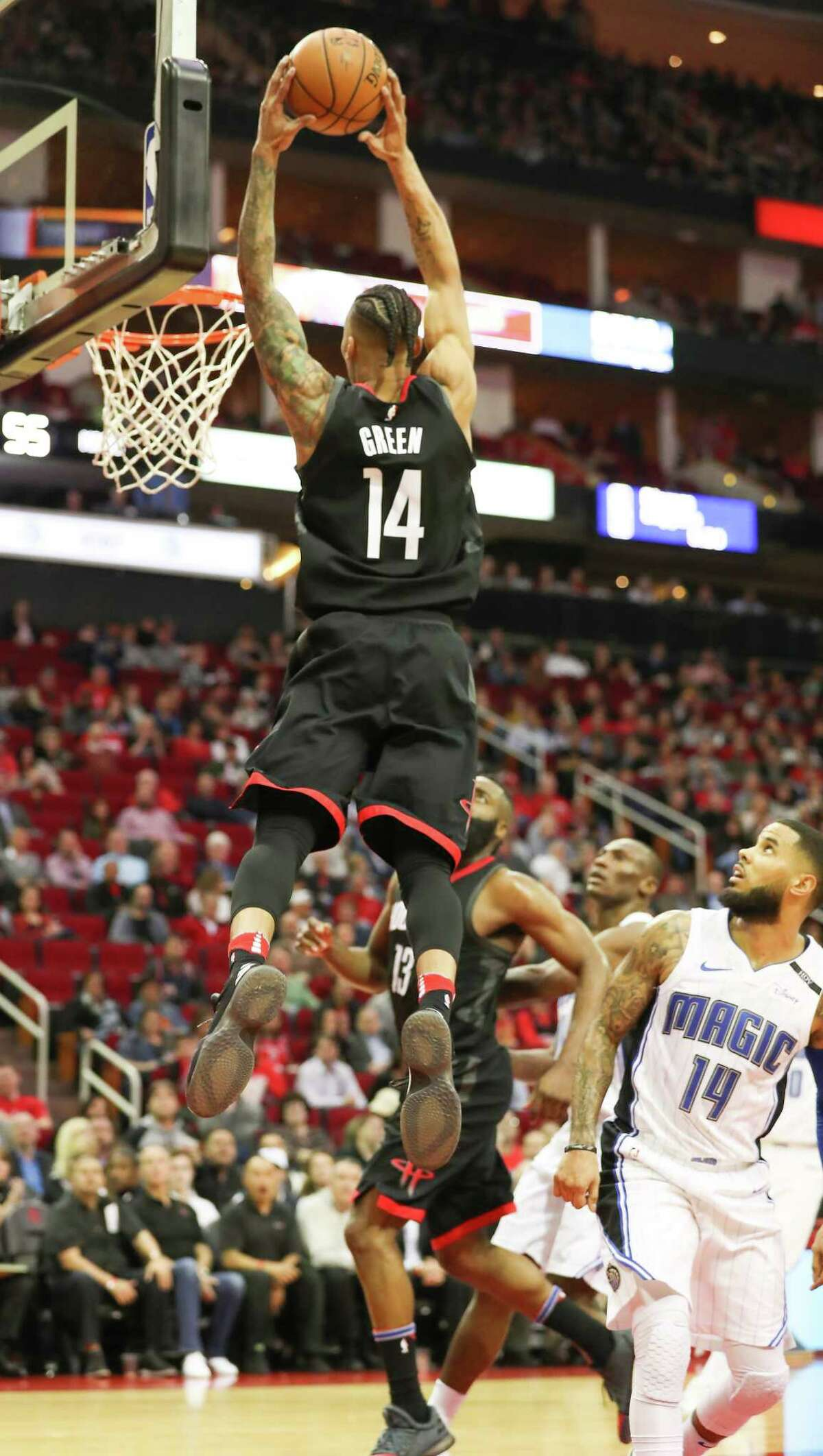 Houston Rockets guard Gerald Green (14) slams a pass from guard James Harden (13) in the 2nd-quarter of an NBA basketball game at Toyota Center on Tuesday, Jan. 30, 2018, in Houston.