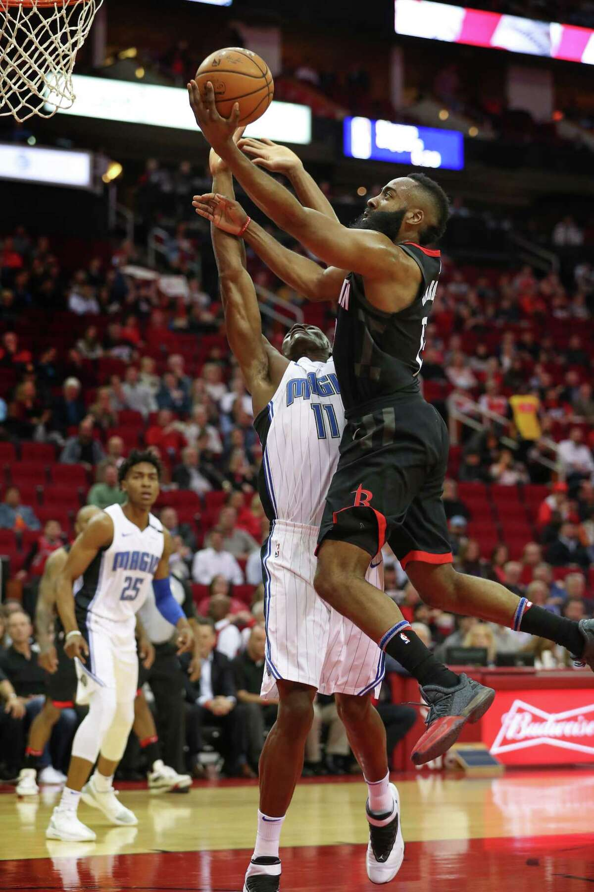 Houston Rockets guard James Harden (13)scores over Orlando Magic center Bismack Biyombo (11) in the 1st-quarter of an NBA basketball game at Toyota Center on Tuesday, Jan. 30, 2018, in Houston.