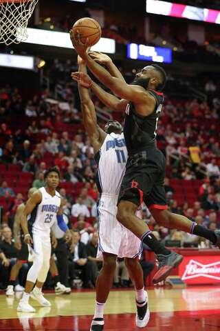 a0dfd8015e9d Houston Rockets guard James Harden (13)scores over Orlando Magic center  Bismack Biyombo (