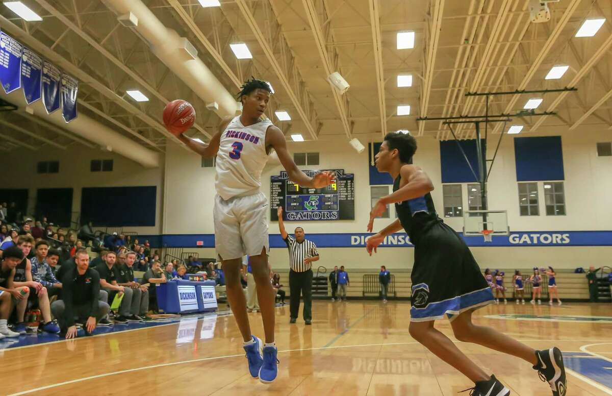 PHOTOS:Houston's top high school basketball recruits to watch January 30, 2018: Dickinson Gators guard Tramon Mark (3) jumps for the rebound during the Boys' high school basketball game between the Clear Springs Chargers and Dickinson Gators in Dickinson, Texas. (Leslie Plaza Johnson/Freelance) >>>A look at the top Class of 2020 high school basketball recruits in the Houston area ...