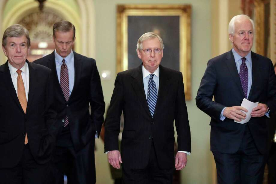 "From left, Sen. Roy Blunt, R-Mo., Sen. John Thune, R-S.D., Senate Majority Leader Mitch McConnell, R-Ky., and Majority Whip John Cornyn, R-Texas, arrive to speak to reporters ahead of President Donald Trump's first State of the Union address, at the Capitol in Washington, Tuesday, Jan. 30, 2018. Amid reports that Trump has wanted to fire special counsel Robert Mueller who is investigating Russian meddling in the 2016 election, McConnell said since he's unaware of any effort, official effort, by the White House to undermine the special counsel, he sees no need to bring up legislation to ""protect someone who doesn't need protection."" (AP Photo/J. Scott Applewhite) Photo: J. Scott Applewhite, Associated Press / Copyright 2018 The Associated Press. All rights reserved."