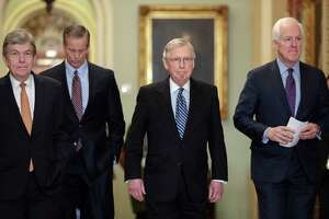 "From left, Sen. Roy Blunt, R-Mo., Sen. John Thune, R-S.D., Senate Majority Leader Mitch McConnell, R-Ky., and Majority Whip John Cornyn, R-Texas, arrive to speak to reporters ahead of President Donald Trump's first State of the Union address, at the Capitol in Washington, Tuesday, Jan. 30, 2018. Amid reports that Trump has wanted to fire special counsel Robert Mueller who is investigating Russian meddling in the 2016 election, McConnell said since he's unaware of any effort, official effort, by the White House to undermine the special counsel, he sees no need to bring up legislation to ""protect someone who doesn't need protection."" (AP Photo/J. Scott Applewhite)"
