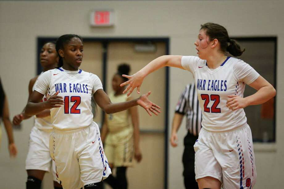 Oak Ridge's Yazmine Kellough (12) and Devan Caldwell (22) slap hands during the girls basketball game against Conroe on Tuesday, Jan. 30, 2018, at Oak Ridge High School. (Michael Minasi / Houston Chronicle) Photo: Michael Minasi, Staff Photographer / © 2017 Houston Chronicle