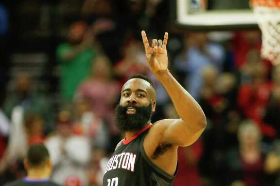Houston Rockets guard James Harden (13) smiles at the crowd after scoring in the 4th-quarter of an NBA basketball game at Toyota Center on Tuesday, Jan. 30, 2018, in Houston.