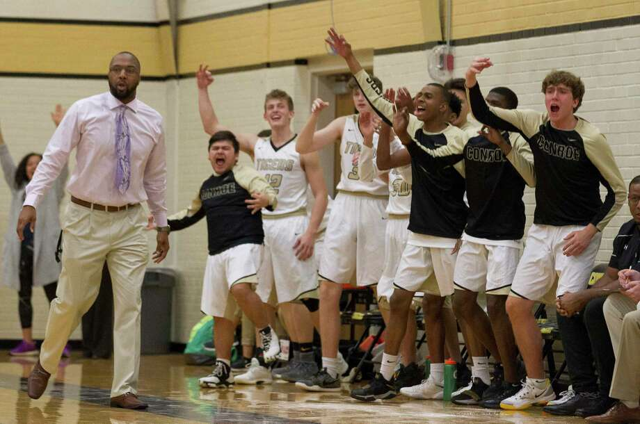 The Conroe bench reacts after a three-pointer by guard Tyrese Lewis during the first quarter of a District 12-6A high school basketball game at Conroe High School, Tuesday, Jan. 30, 2018, in Conroe. Photo: Jason Fochtman, Staff Photographer / © 2018 Houston Chronicle