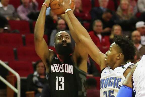 Houston Rockets guard James Harden (13) shoots under pressure by Orlando Magic forward Wesley Iwundu (25) in the 2nd-quarter of an NBA basketball game at Toyota Center on Tuesday, Jan. 30, 2018, in Houston.