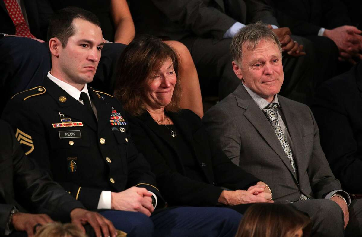 WASHINGTON, DC - JANUARY 30: Army Staff Sergeant Justin Peck sits with Fred and Cindy Warmbier during the State of the Union address in the chamber of the U.S. House of Representatives January 30, 2018 in Washington, DC. He is credited with clearing a hospital in Syria of IEDs and saving another soldier's life. (Photo by Alex Wong/Getty Images)