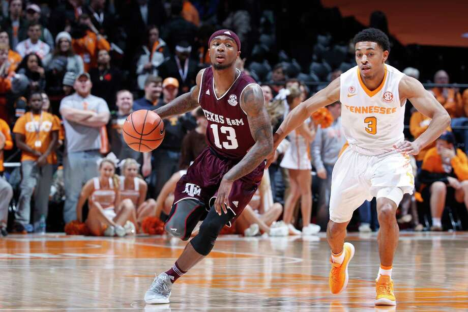 KNOXVILLE, TN - JANUARY 13: Duane Wilson #13 of the Texas A&M Aggies dribbles up court against James Daniel III #3 of the Tennessee Volunteers in the second half of a game at Thompson-Boling Arena on January 13, 2018 in Knoxville, Tennessee. Tennessee won 75-62. Photo: Joe Robbins, Getty Images / 2018 Getty Images
