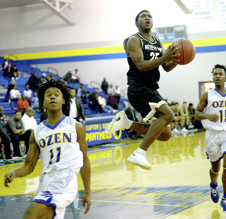 Nederland's Johnathan Rayford gets a shot on basket after skirting past Ozen's defense during their district match-up at Ozen Tuesday. Photo taken Tuesday, January 30, 2018 Kim Brent/The Enterprise Photo: Kim Brent, Beaumont Enterprise / BEN