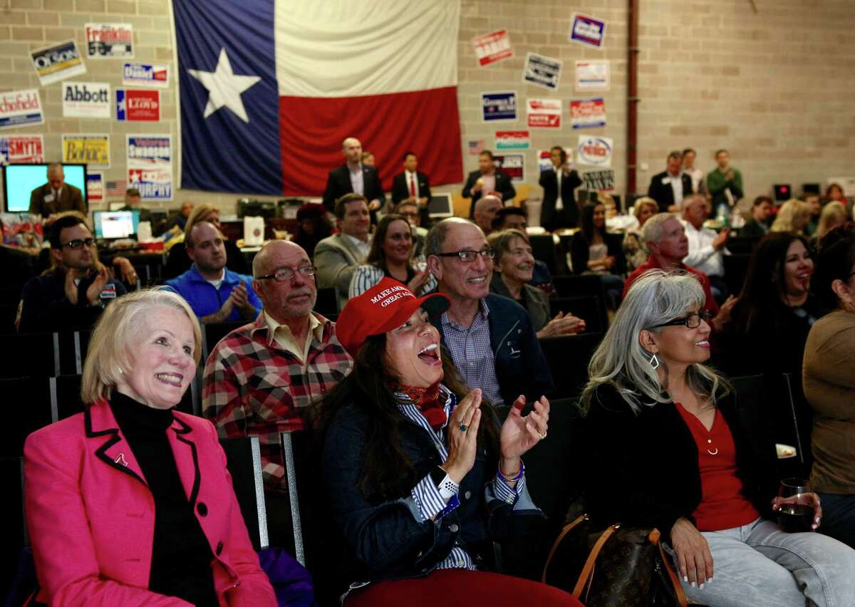 Elisa Sharp, in red hat, cheers at the beginning of the State of the Union speech during a watch party at the Harris County Republican Party headquarters, Tuesday, January 30, 2018, in Houston. Sharp emigrated to the United States from Mexico as a child when her father, and engineer, obtained a green card to work in the United States. Sharp became a citizen when she turned 18 in 1983.