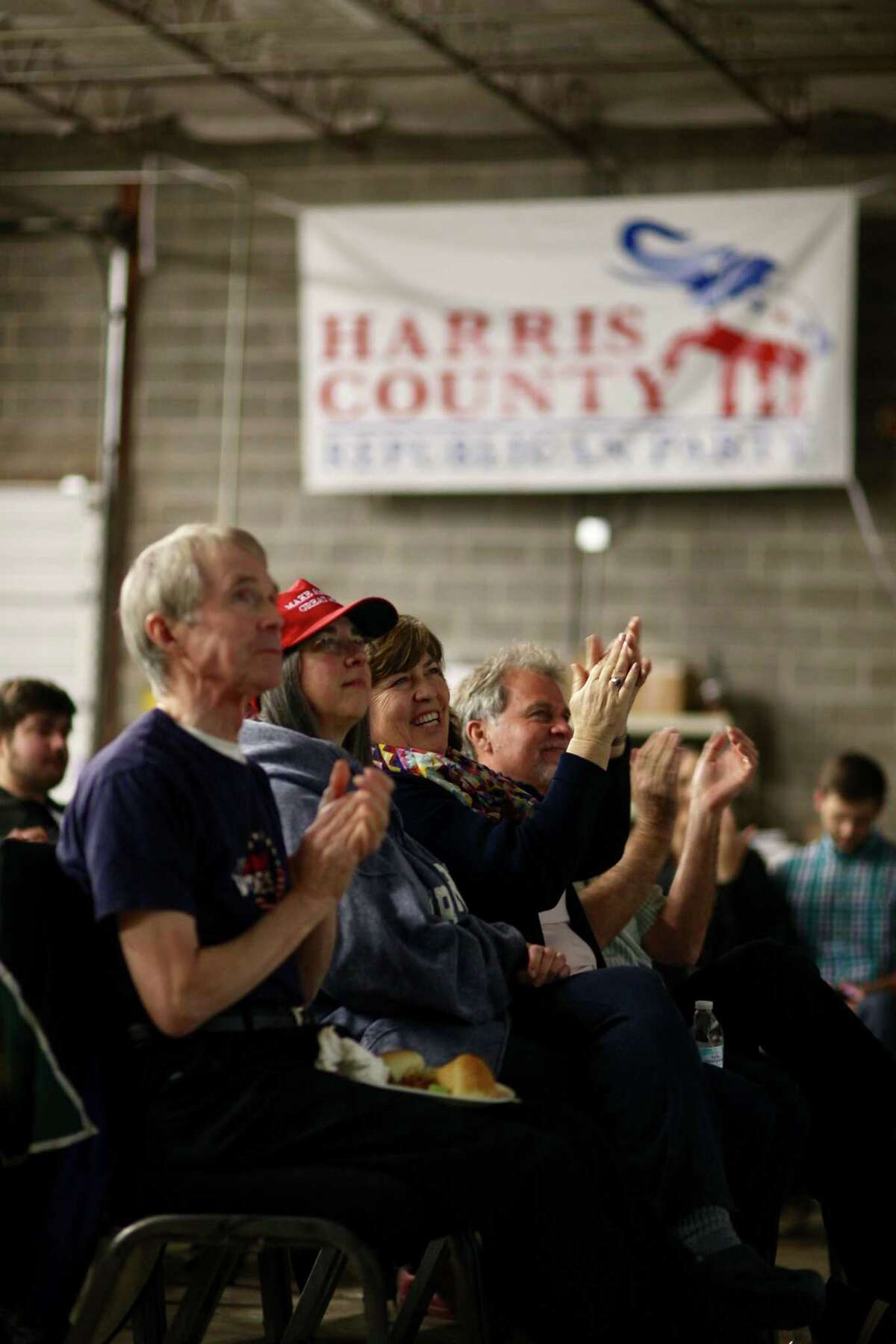 Viewers watch the State of the Union speech during a watch party at the Harris County Republican Party headquarters, Tuesday, January 30, 2018, in Houston.