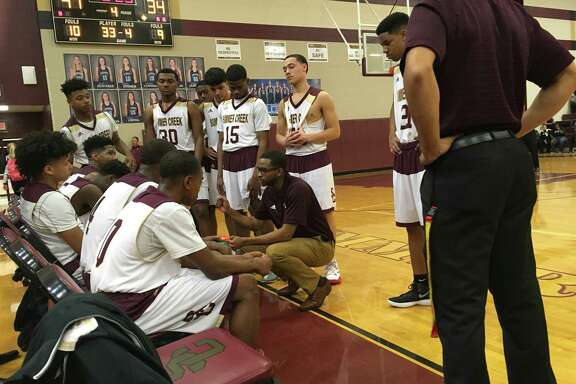 Summer Creek basketball coach Kevin Woods talks to his team during a timeout in the fourth quarter of their game against Kingwood on Jan. 30 at Summer Creek High School