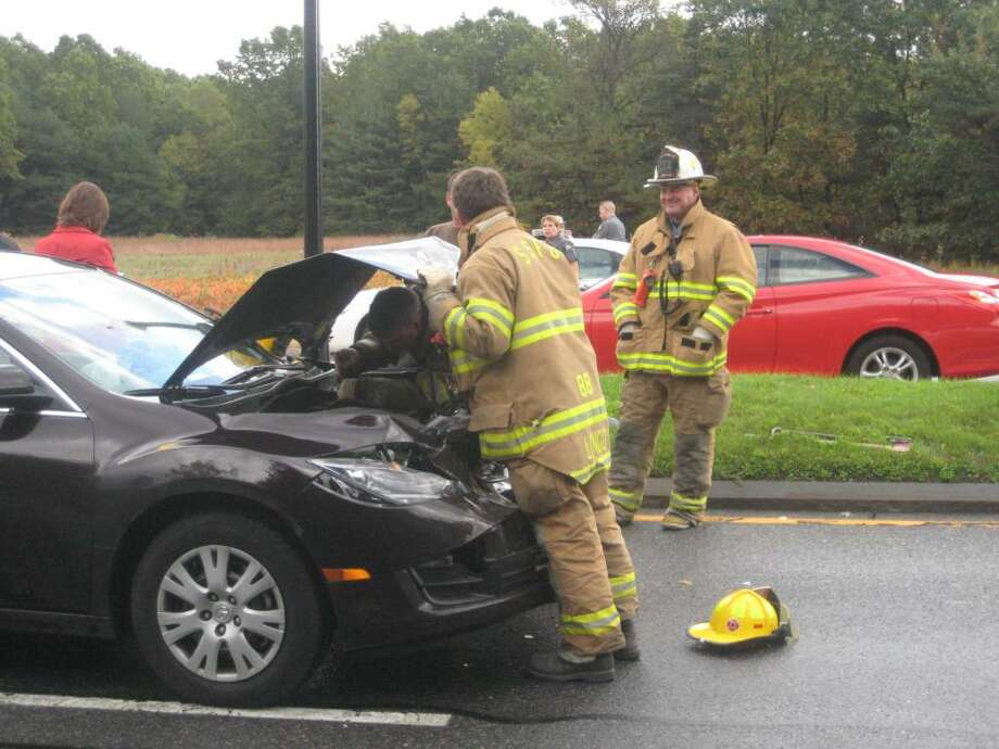 A police car driven by Saratoga Springs officer Thomas Sartin was rear-ended by a car operated by Erin Dreyer this morning on Route 9, just south of Avenue of the Pines, city police said. Sartin was taken to the hospital with head and neck injuries. (Leigh Hornbeck / Times Union)