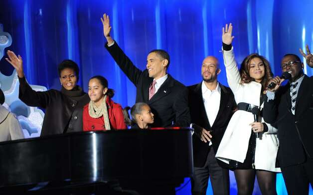 In this image released by PictureGroup, from left, First Lady Michelle Obama, Malia Obama, Sasha Obama, U.S. President Barack Obama, singers Common and Jordin Sparks, and Randy Jackson attend the National Christmas Tree Lighting Ceremony at President's Park on Thursday, Dec. 3, 2009, in Washington. (Photo by Scott Gries/PictureGroup for NPS) Photo: Scott Gries