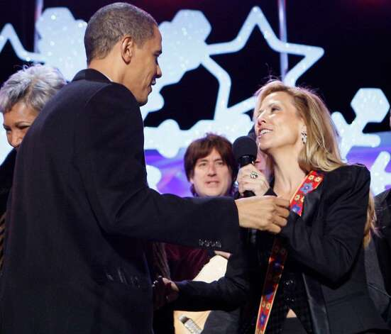 President Barack Obama greets singer Sheryl Crow at the National Christmas Tree Lighting Ceremony in Washington, Thursday, Dec. 3, 2009. (AP Photo/Charles Dharapak) Photo: Charles Dharapak / AP
