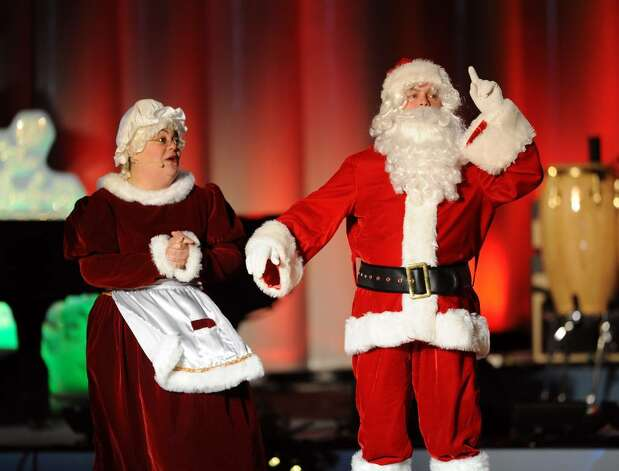 Santa and Mrs. Claus perform during The 2009 National Christmas Tree Lighting on December 03, 2009 in Washington, DC.   AFP PHOTO / Tim Sloan (Photo credit should read TIM SLOAN/AFP/Getty Images) Photo: TIM SLOAN / AFP