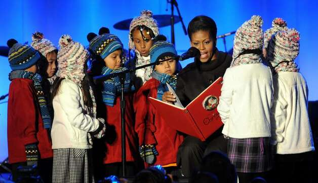 "US First Lady Michelle Obama reads ""The Night Before Christmas"" during the 2009 National Christmas Tree Lighting on December 03, 2009 in Washington, DC   AFP PHOTO / Tim Sloan (Photo credit should read TIM SLOAN/AFP/Getty Images) Photo: TIM SLOAN / AFP"