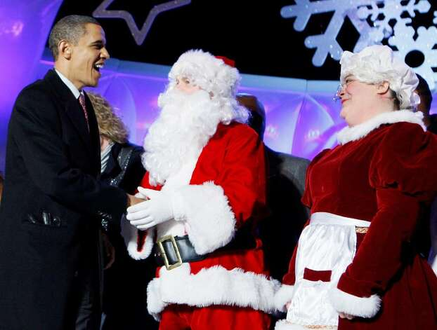 President Barack Obama greets Santa Claus and Mrs. Claus, played by Brad and Victoria Oscar, as they participate in the National Christmas Tree Lighting Ceremony in Washington, Thursday, Dec. 3, 2009. (AP Photo/Charles Dharapak) Photo: Charles Dharapak / AP