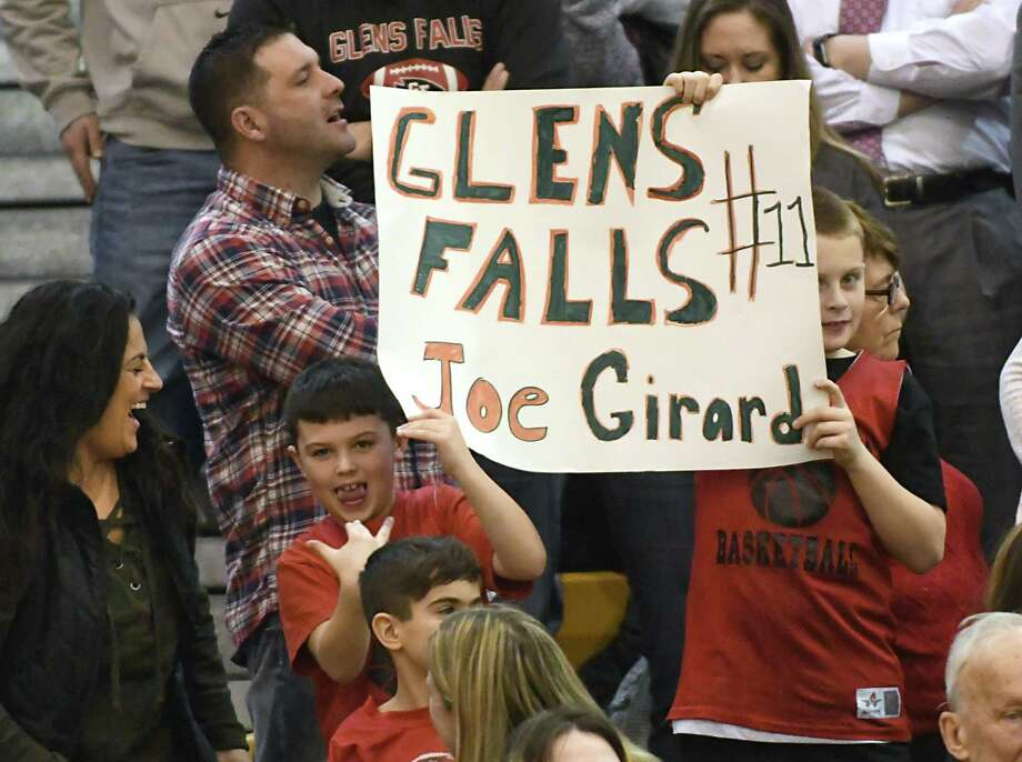 Glens Falls' Joseph Girard III fans hold up a sign during a basketball game against Amsterdam on Tuesday, Jan. 30, 2018 in Amsterdam, N.Y. (Lori Van Buren/Times Union) Photo: Lori Van Buren / 20042764A