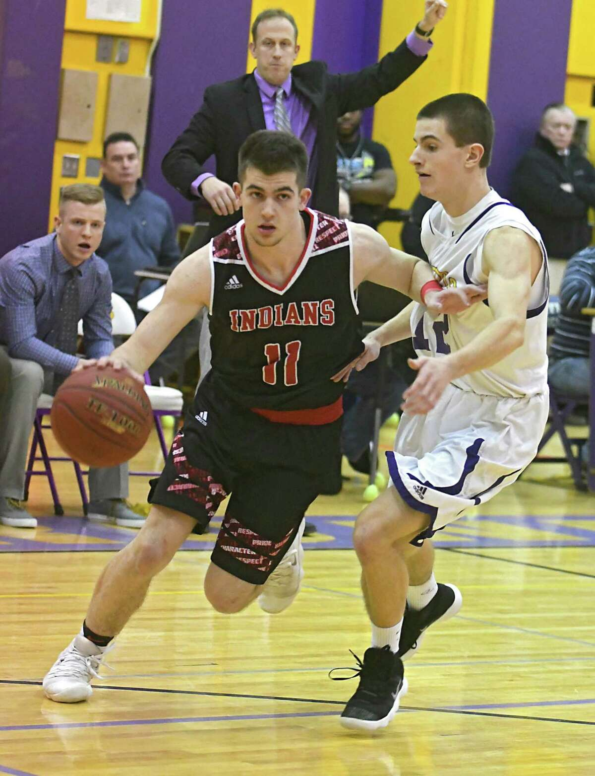 Glens Falls' Joseph Girard III drives to the basket guarded by Amsterdam's Jeffrey Brennan during a basketball game on Tuesday, Jan. 30, 2018 in Amsterdam, N.Y. (Lori Van Buren/Times Union)