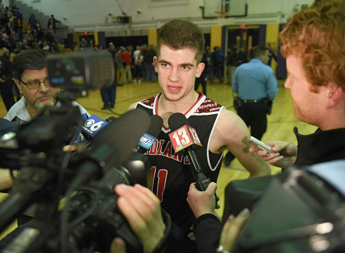 Glens Falls' Joseph Girard III talks to the press after passing New York stateOs all-time boys basketball scoring record during a basketball game against Amsterdam on Tuesday, Jan. 30, 2018 in Amsterdam, N.Y. He passed the record of 2,946 points held by current Indiana Pacers Lance Stephenson. (Lori Van Buren/Times Union)
