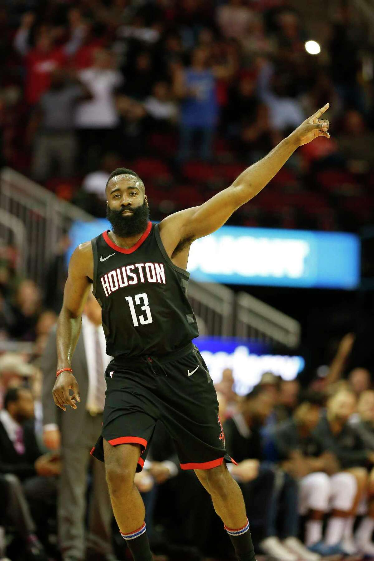 Houston Rockets guard James Harden (13) pointed to the goal after he scored in the 4th-quarter of an NBA basketball game at Toyota Center on Tuesday, Jan. 30, 2018, in Houston. ( Steve Gonzales / Houston Chronicle )