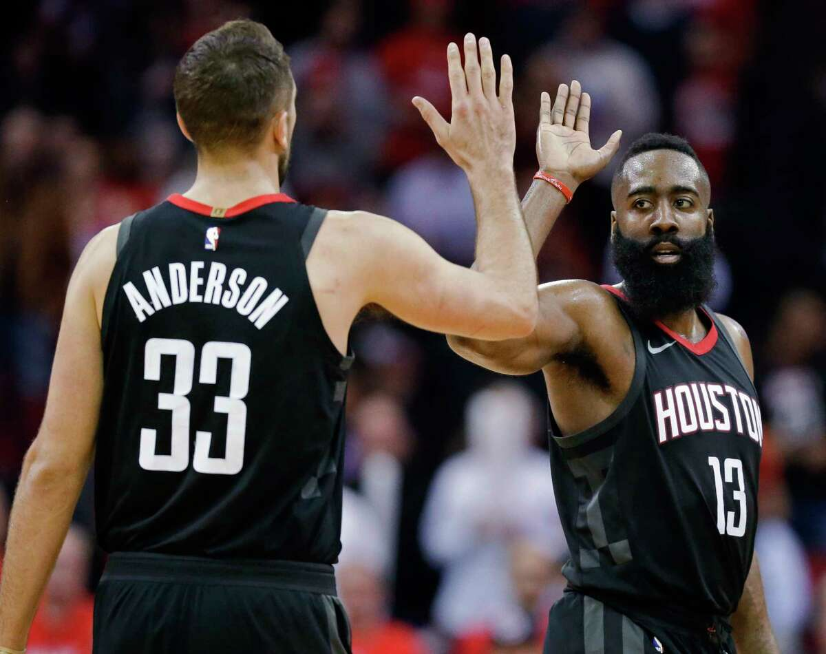 Houston Rockets guard James Harden (13) high-fives Ryan Anderson late in the second half of the team'sp NBA basketball game against the Orlando Magic, Tuesday, Jan. 30, 2018, in Houston. Houston won 114-107. (AP Photo/Eric Christian Smith)