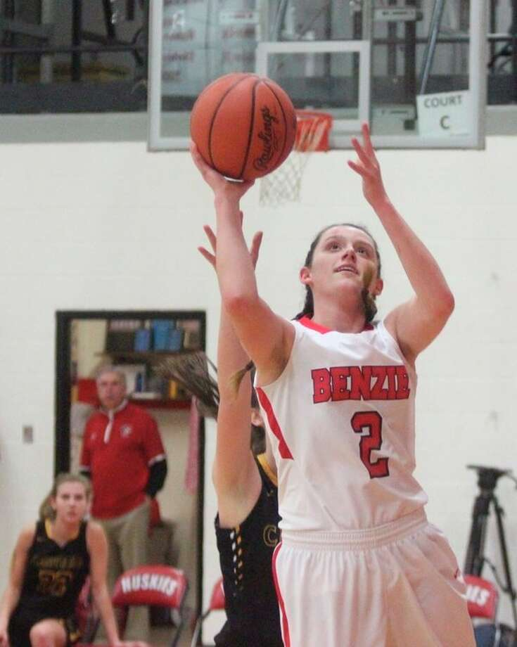 Abby Bretzke surges past a defender for a transition layup. (Photo/Robert Myers)