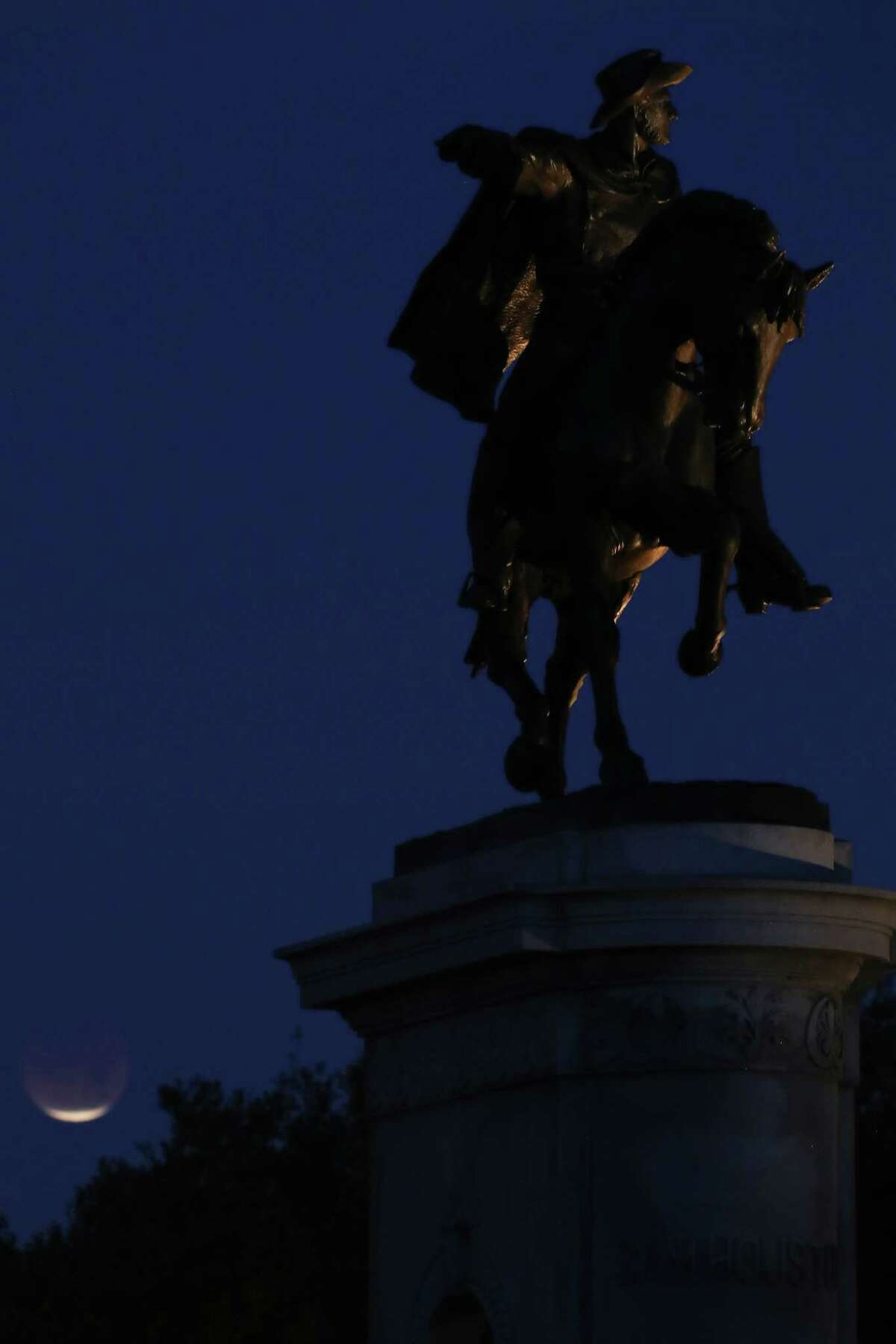The super blue blood moon was visible behind the Sam Houston Monument in Hermann Park Wednesday, Jan. 31, 2018, in Houston. The celestial event is known as a