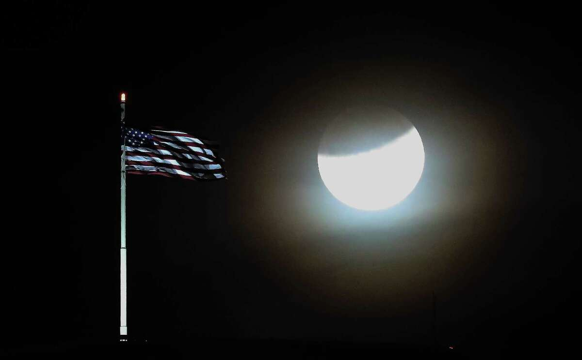 The super blue blood moon was visible over the AIG Building Wednesday, Jan. 31, 2018, in Houston. The celestial event is known as a