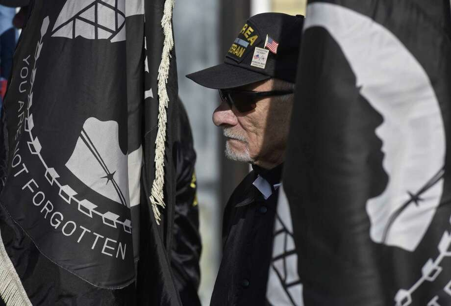 Above, Joseph Gatto, of Danbury, takes part in the annual bell ringing ceremony in New Milford by the POW/MIA Connecticut Forget-Me-Nots organization, marking the Paris Peace Accords and the end of the Vietnam War on Saturday morning. Gatto is a member of the Chapter 11 Korean Wars Veterans Association. Below, bell ringing. Photo: H John Voorhees III / Hearst Connecticut Media / The News-Times