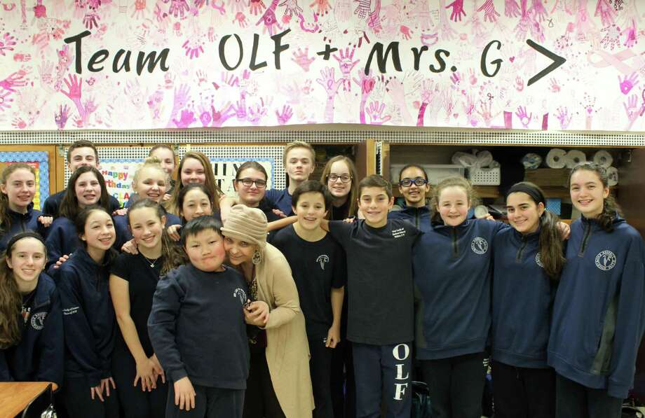 Longtime math teacher Geri Galasso with her eighth-grade homeroom class at Our Lady of Fatima School in Wilton. Photo: Stephanie Kim / Hearst Connecticut Media