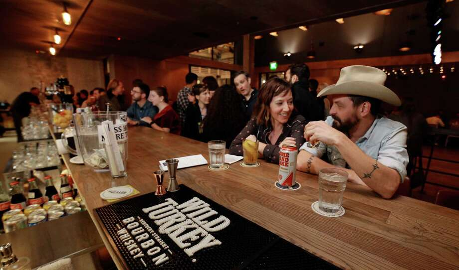 Heather Rowell and Daniel Drake take in the atmosphere at the bar in Goodnight Charlie's, a new honky-tonk in Montrose. Photo: Michael Wyke, Freelance / © 2018 Houston Chronicle