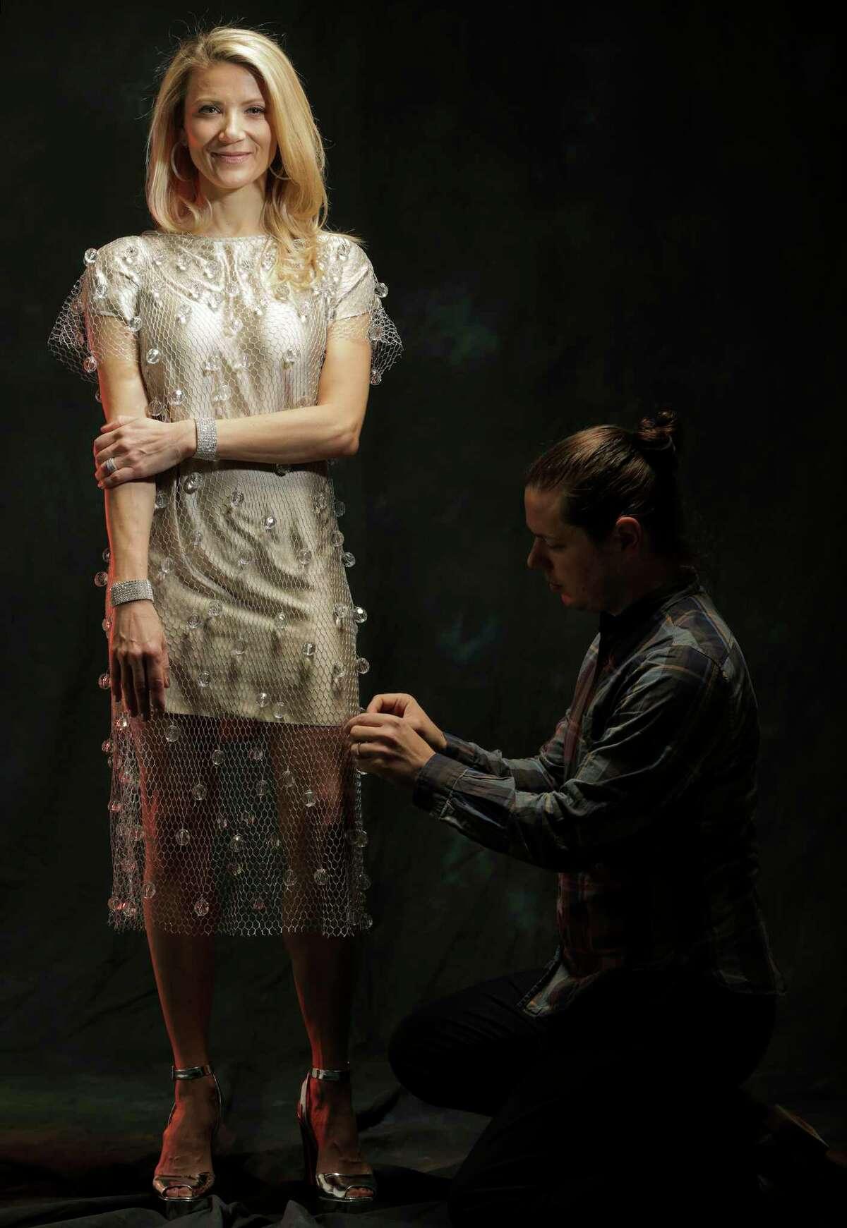 Fresh Arts Ball co-chair Stephanie Cockrell models Miles David designer David Peck's custom dress for the