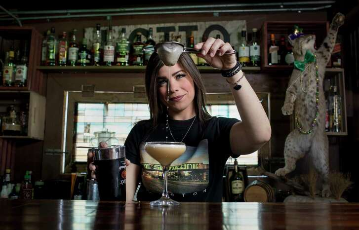 Alli Genoway, bartender at Bobcat Teddy's Icehouse, makes an apricot basil sour Monday, Jan. 29, 2018, in Houston.  ( Jon Shapley / Houston Chronicle )