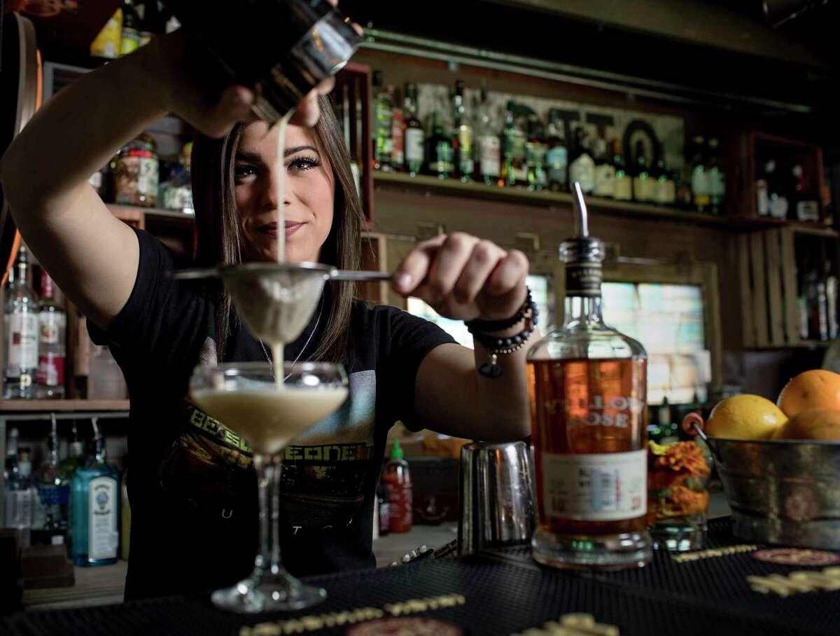 Alli Genoway, bartender at Bobcat Teddy's Icehouse, makes an apricot basil sour Monday, Jan. 29, 2018, in Houston. ( Jon Shapley / Houston Chronicle )