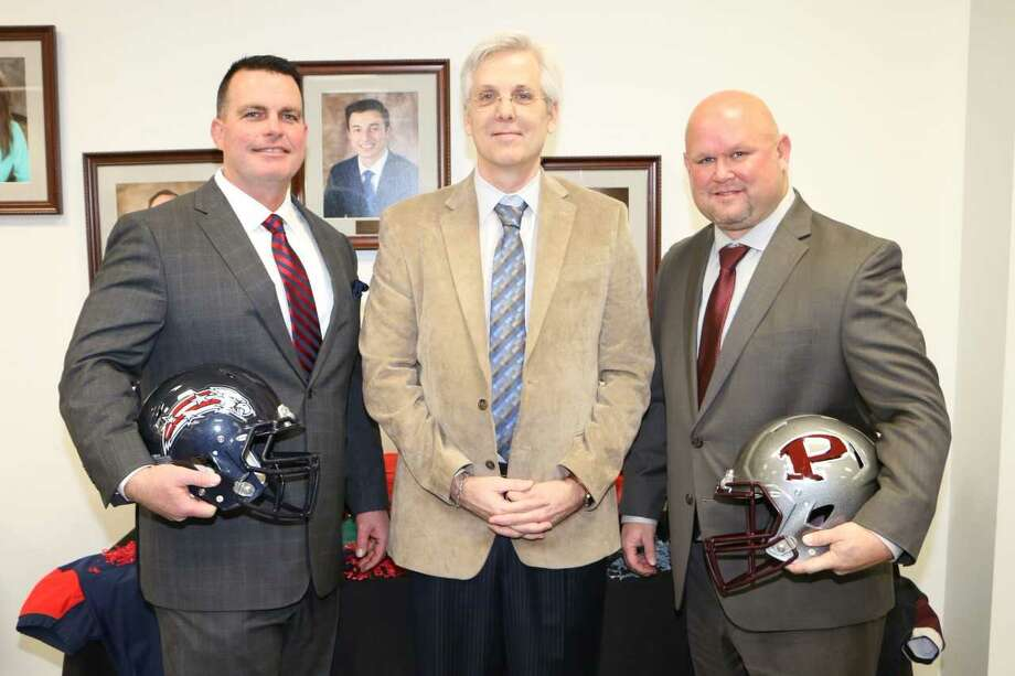 New Dawson head football coach Mike Allison (left) and new Pearland head football coach Ricky Tullos (right) are shown with Pearland ISD superintendent Dr. John Kelly. Photo: Submitted Photo