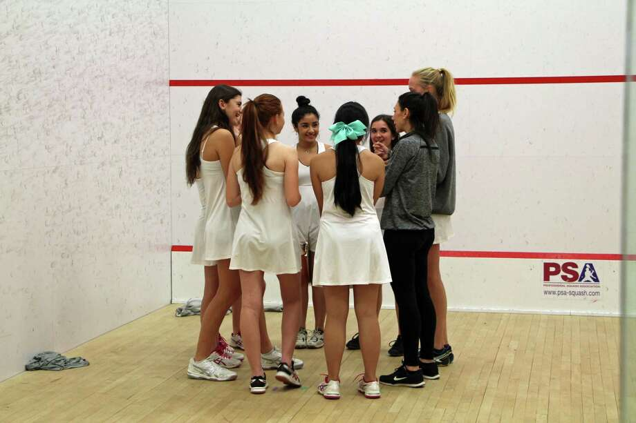 The St. Luke's girls squash team huddles during a match. Photo: Contributed Photo / Darien News contributed