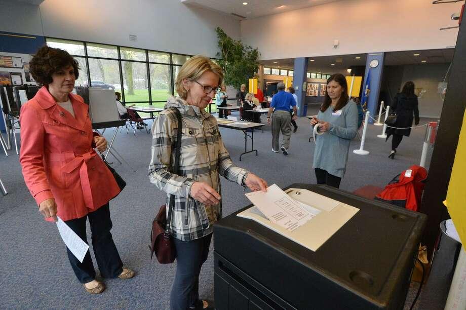 Joan Norfleet casts her vote at Wilton High School District 1 during presidential primary voting in Wilton. Photo: Alex Von Kleydorff / Hearst Connecticut Media / Connecticut Post