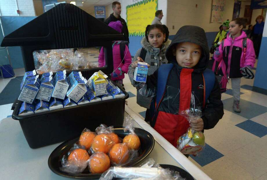 Students at Kendall Elementary School including second-grader Alejandro Maradiaga-Arias take advantage of the school's Grab and Go breakfast program Tuesday, January 30, 2018, in Norwalk, Conn. A team from the American Association of School Administrators, the organization responsible for the grab n' go breakfast grant, were at Kendall on Tuesday to see the program in action. Photo: Erik Trautmann / Hearst Connecticut Media / Norwalk Hour