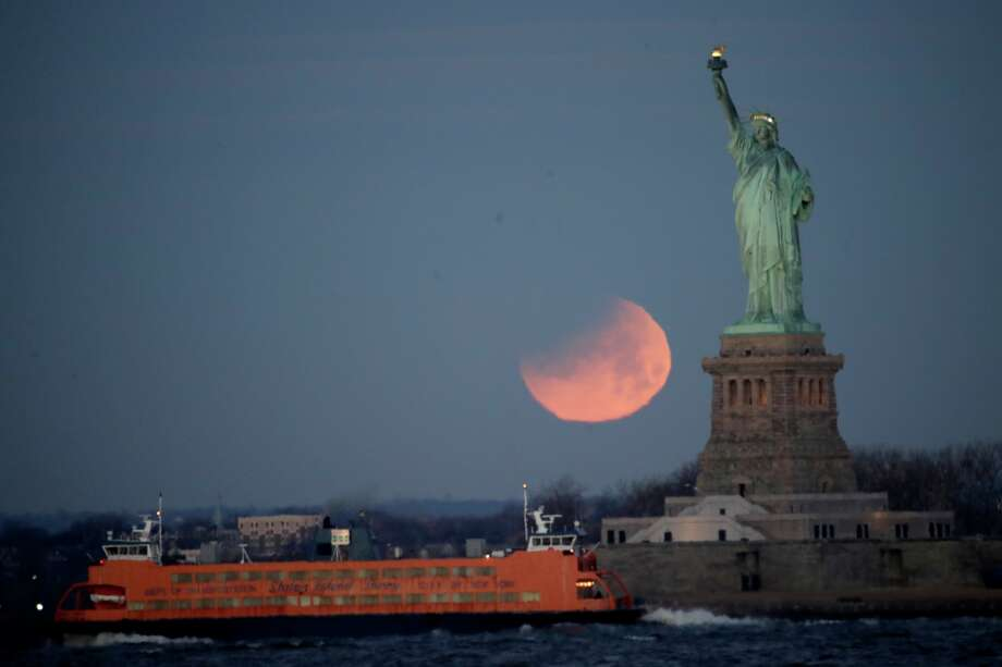 The supermoon, which is the final of three consecutive supermoons, also experience lunar eclipse as it set over the horizon, but only a partial eclipse was visible around the world.>>Click through the images to see more >> Photo: Julio Cortez/AP