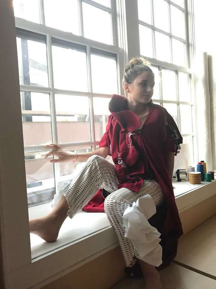 A 16-year-old student sports a design of her own at the New England Fashion and Design Association. Norwalk's first Children's Arts and Design Festival will take place this May and is currently accepting entries. Photo: Contributed Photo
