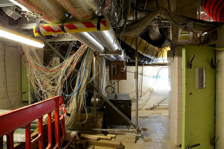 """A handout picture released by the UK Parliament on January 30, 2018 and taken on April 24, 2014 shows one of the 100 plant rooms in the basement of the Palace of Westminster in London.    British lawmakers were set to deabte the proposed restoration of the Palace of Westminster, the historic palace that houses the UK Houses of Parliament. A parliamentary report published in 2016 recommended that lawmakers should move out of the crumbling building while it is renovated to avert a crisis. Behind its neo-Gothic facades topped by the world-famous Big Ben clock tower, the mother of parliaments has been eroded by air pollution, overrun with mice and crumbling, prompting warnings it may have to be permanently abandoned unless urgent renovations are carried out costing billions of pounds.  / AFP PHOTO / UK PARLIAMENT / HO / RESTRICTED TO EDITORIAL USE - MANDATORY CREDIT  """" AFP PHOTO / UK PARLIAMENT """"  -  NO MARKETING NO ADVERTISING CAMPAIGNS   -   DISTRIBUTED AS A SERVICE TO CLIENTS SPECIFICALLY TO ILLUSTRATE THE AFP STORY BY JOE JACKSON DATED JAN 31, 2018 -  NO ARCHIVE - RESTRICTED TO SUBSCRIPTION USE - NO SALES - NO USE ON ANY SOCIAL MEDIA PLATFORM - NOT TO BE ADAPTED ALTERED OR MANIPULATED  / TO GO WITH AFP STORY BY JOE JACKSONHO/AFP/Getty Images Photo: HO, AFP/Getty Images"""